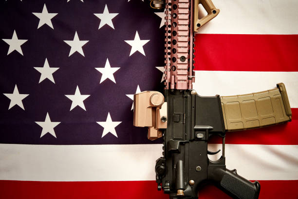 top view of a machine gun on the background of the USA flag top view of a machine gun set against the background of the USA flag ar 15 stock pictures, royalty-free photos & images