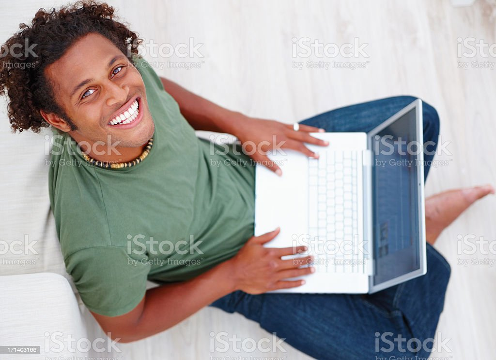 Top view of a man smiling and using laptop royalty-free stock photo