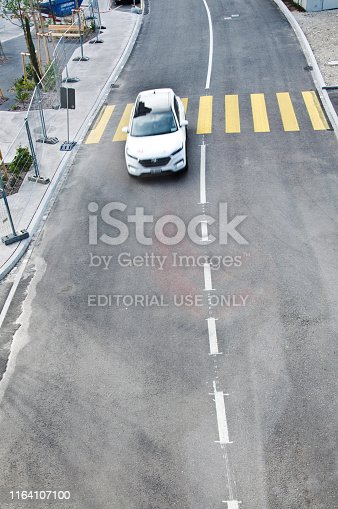 144334852 istock photo Top view of a motorway/street traffic. A swiss motorist drive over a zebra crossing in Basel - Switzerland 1164107100