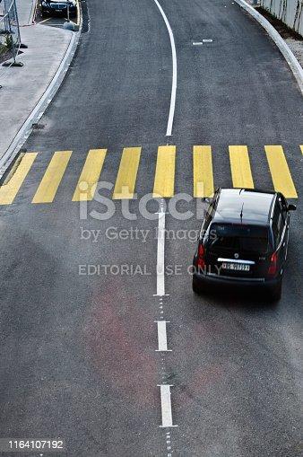 144334852 istock photo Top view of a motorway/street traffic. A swiss motorist drive over a zebra crossing in Basel - Switzerland 1164107192