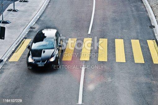 144334852 istock photo Top view of a motorway/street traffic. A swiss motorist drive over a zebra crossing in Basel - Switzerland 1164107229