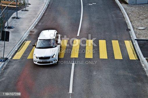 144334852 istock photo Top view of a motorway/street traffic. A swiss motorist drive over a zebra crossing in Basel - Switzerland 1164107259