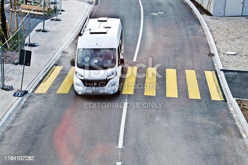 144334852 istock photo Top view of a motorway/street traffic. A swiss motorist drive over a zebra crossing in Basel - Switzerland 1164107282