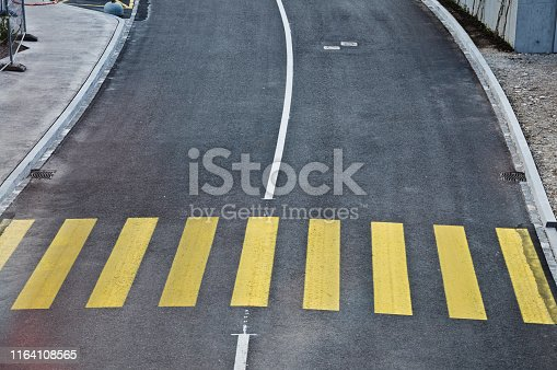 144334852 istock photo Top view of a motorway/street traffic. A zebra crossing 1164108565