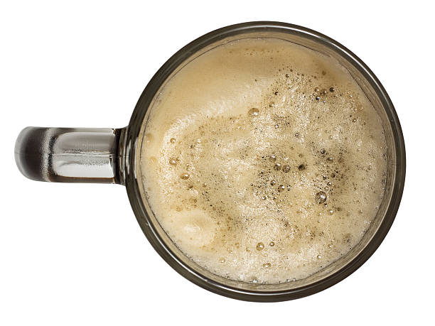 top view of a mug of beer and foam - dark beer stock photos and pictures