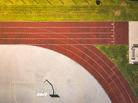 Top view of a numbered running tracks at sports athletic stadium