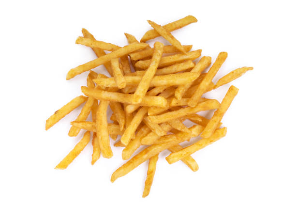 top view of a pile of cooked french fries - patatine foto e immagini stock
