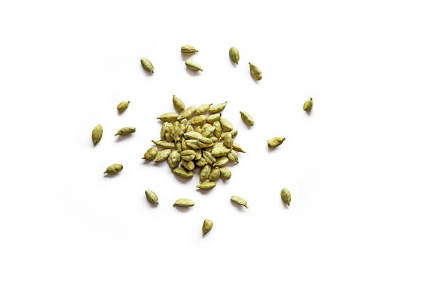 Top view of a pile of organic dry cardamom seeds Top view of a pile of organic dry cardamom seeds isolated on a white background cardamom stock pictures, royalty-free photos & images