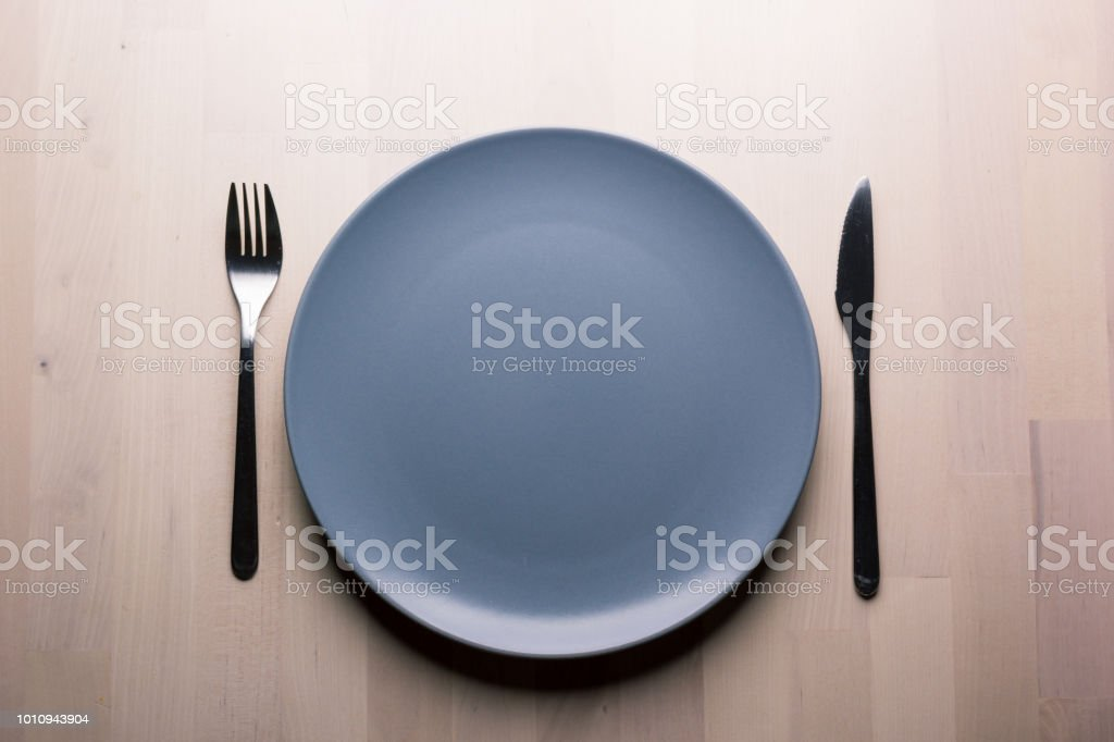 Top view of a restaurant table with plate, knife and fork, restaurant...