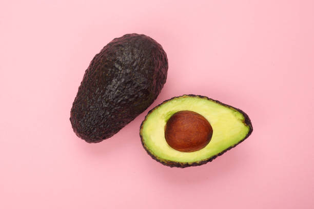Top view of a ripe sliced avocado isolated stock photo