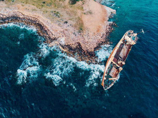 Top view of a ship stranded near the shore. stock photo