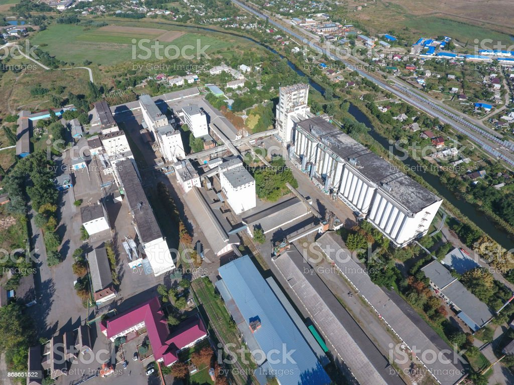 Top view of a silo elevator. Aerophotographing industrial object. stock photo