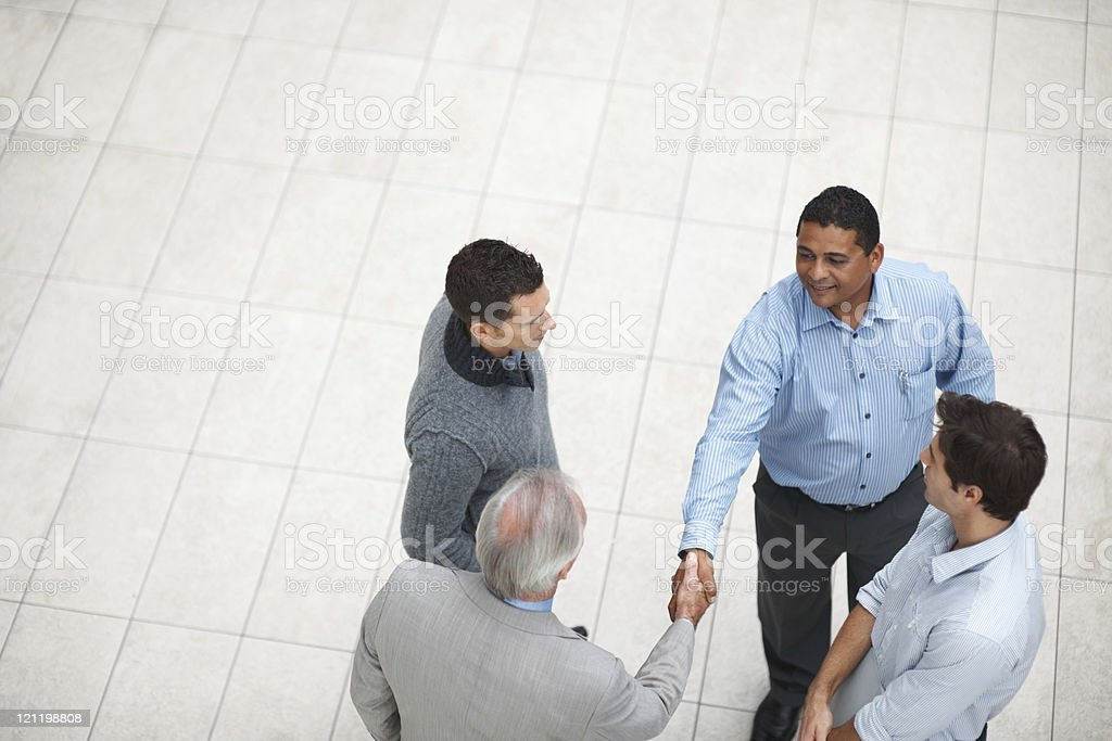 Top view of a successful business partners handshaking at work royalty-free stock photo
