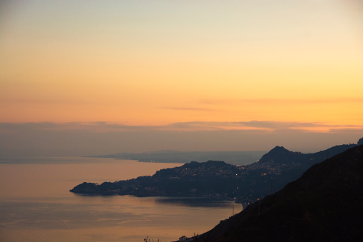 Top view of a sunset on the Ionian coast in Sicily