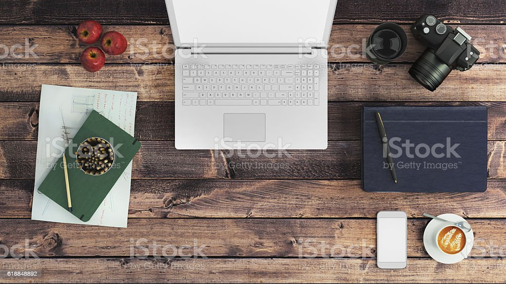 Top view of a table with a laptop stock photo