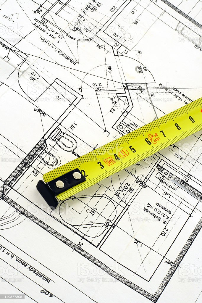 Top view of a tape measure on blueprint royalty-free stock photo