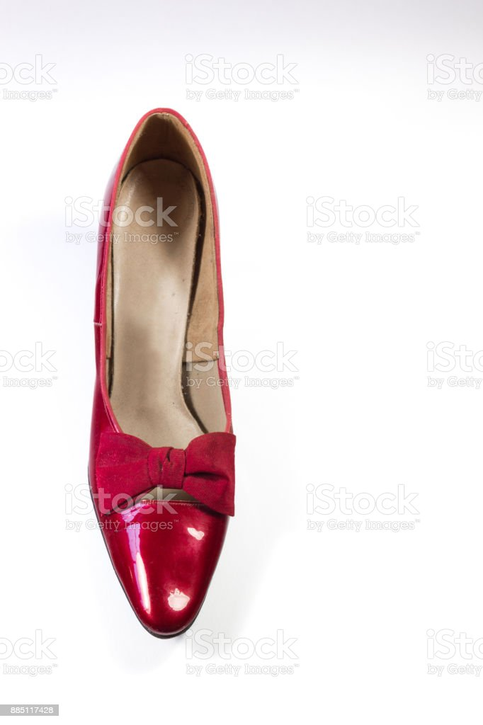 Top view of a vintage woman's shoe in ruby red pleather, isolated on white stock photo