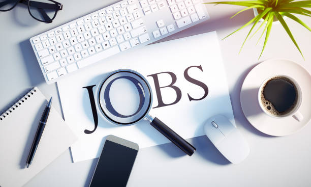 Top view of a white desktop - Concept job search stock photo