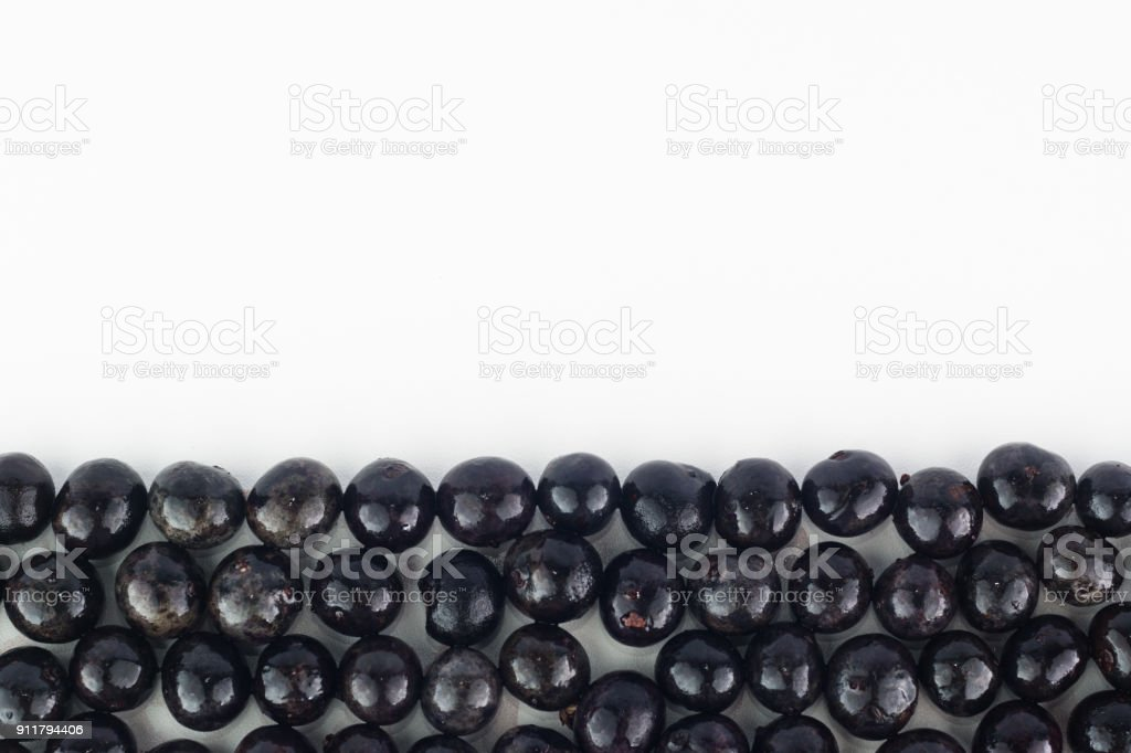 Top view of acai berry, native fruit from brazilian amazon, on white background for banner design stock photo