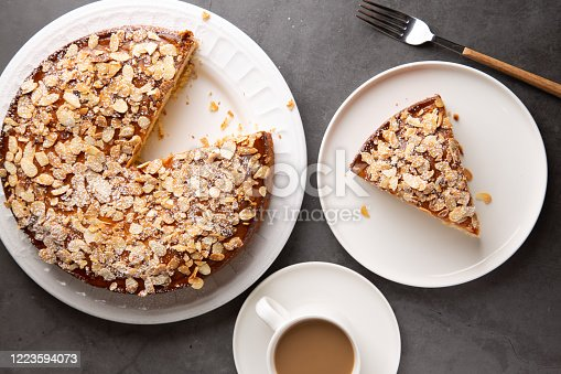 istock Top view of almond and lemon cake with a coffee 1223594073