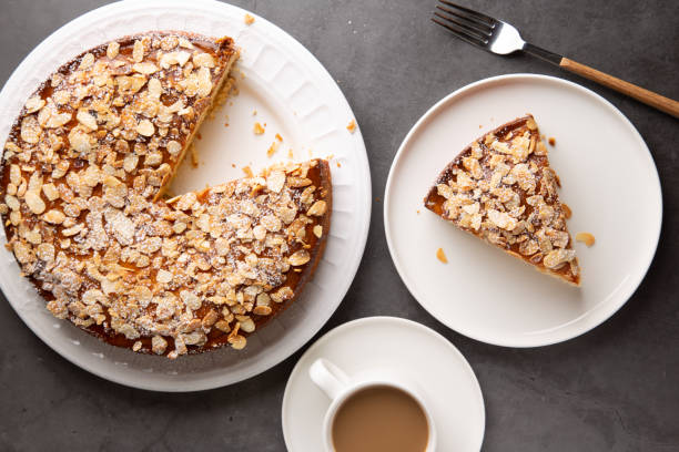 Top view of almond and lemon cake with a coffee stock photo