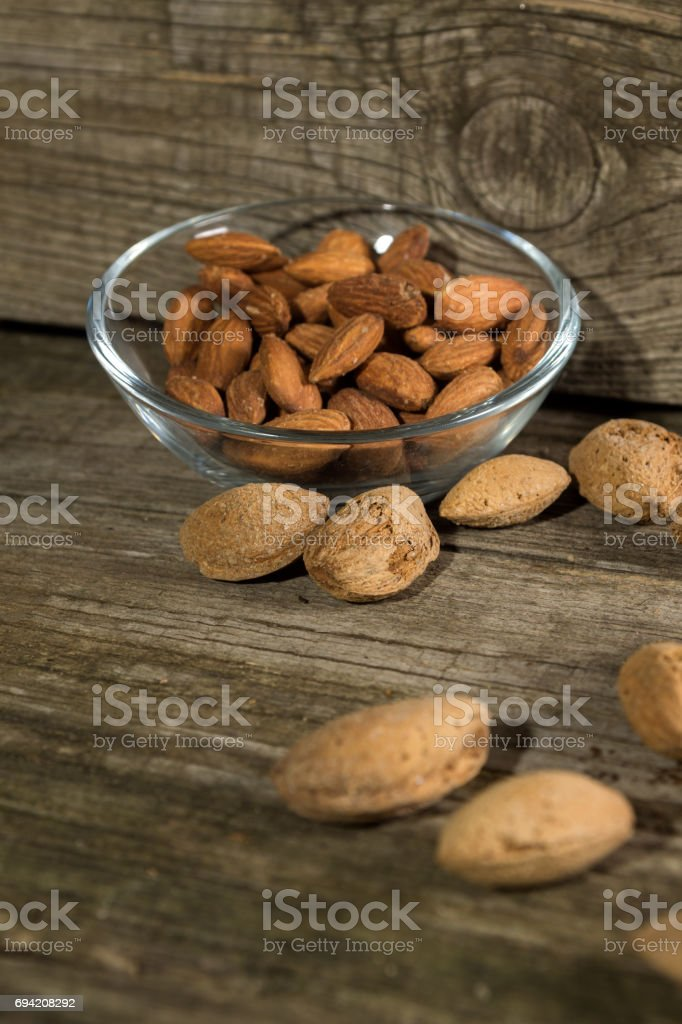 Top view of Almonds over rustic background stock photo