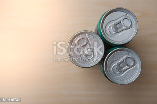 istock Top view of aluminum cans in droplets of water on wood 824616702