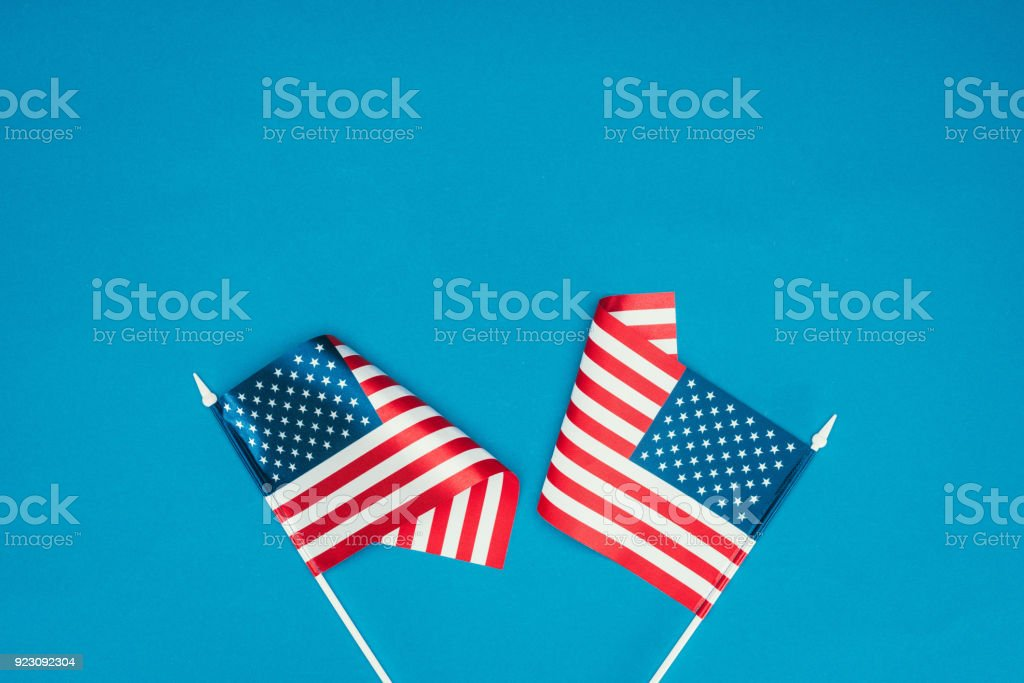 top view of american flags isolated on blue, presidents day concept stock photo