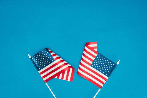 top view of american flags isolated on blue, presidents day concept - july stock photos and pictures