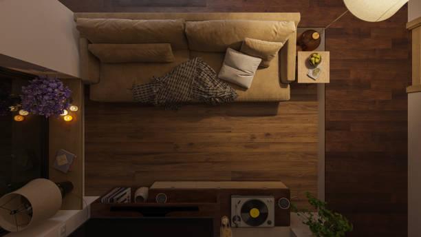 Top-Ansicht eines beleuchteten Wohnzimmers mit Möbeln in Dim-Beleuchtung – Foto