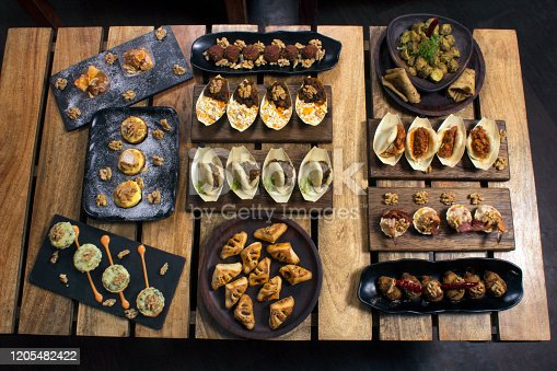 508216406 istock photo Top view of appetizers or snacks, tapas to be had with drinks 1205482422