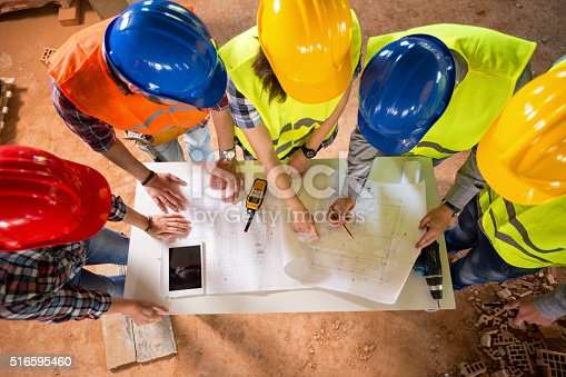 516607254istockphoto Top view of architects check blue print 516595460