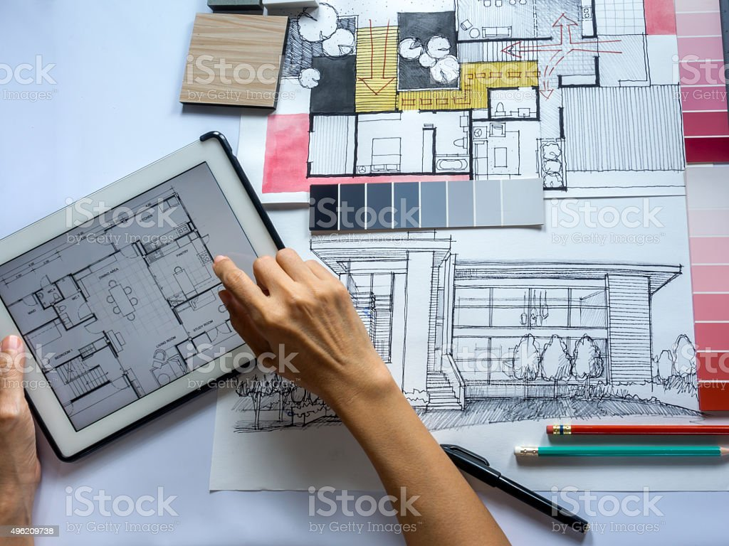 Top view of Architects & Interior designers hands working on table...