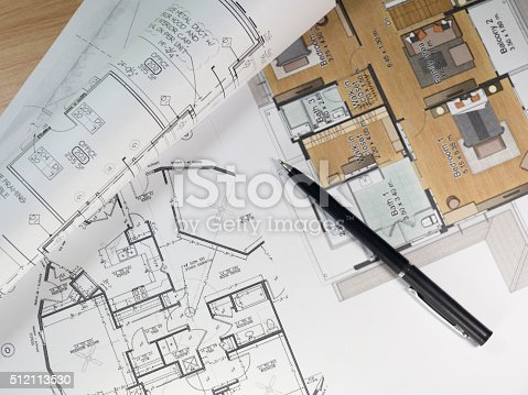 istock Top view of architectural blueprints and blueprint rolls 512113530