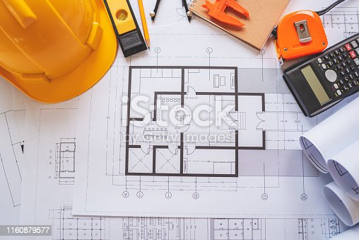1174841541 istock photo Top view of architectural blueprints on the worktable. 1160879577