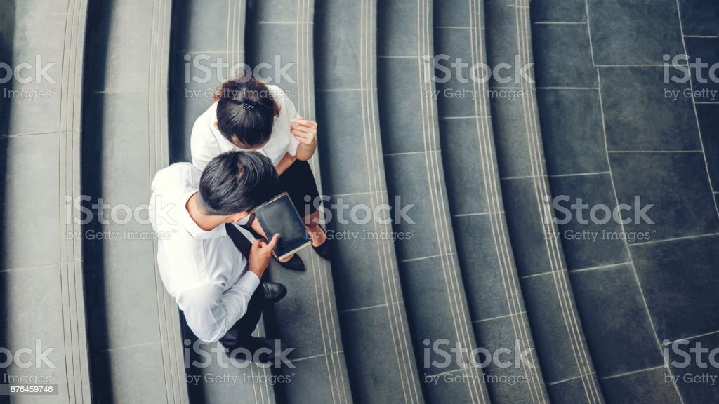 Top view of Asian business people meeting and using digital tablet outdoor after work - foto stock
