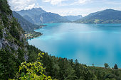 Top view of Attersee lake, Austria, as seen from the via ferrata route above it, on a clear, hot, Summer day.
