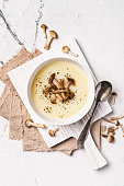 istock Top view of autumn vegetable cream soup in brown bowl with honey agarics or armillaria 1201825885