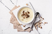istock Top view of autumn vegetable cream soup in brown bowl with honey agarics or armillaria 1201825931