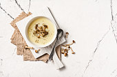 istock Top view of autumn vegetable cream soup in brown bowl with honey agarics or armillaria 1201825965