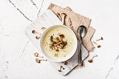 istock Top view of autumn vegetable cream soup in brown bowl with honey agarics or armillaria 1201825981