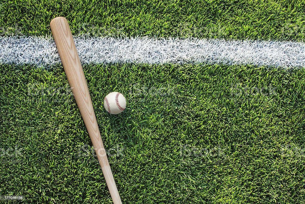 Top view of baseball bat and ball on grass stock photo