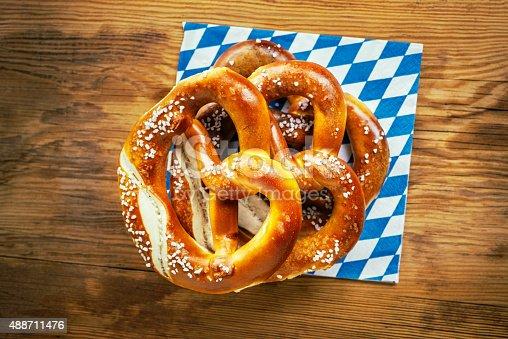 istock Top view of bavarian pretzel on wooden table, Oktoberfest 488711476