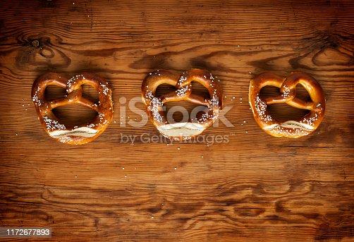 istock Top view of bavarian pretzels on wooden table, Oktoberfest Munich 1172677893