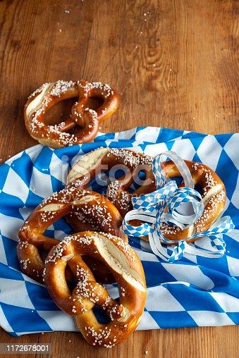 istock Top view of bavarian pretzels on wooden table, Oktoberfest Munich 1172678001