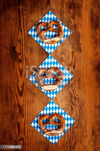istock Top view of bavarian pretzels on wooden table, Oktoberfest Munich 1172685402