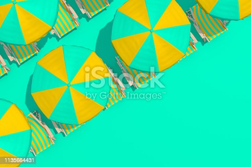 istock Top view of beach umbrella and chair on the green color background, minimal summer concept 1135664431