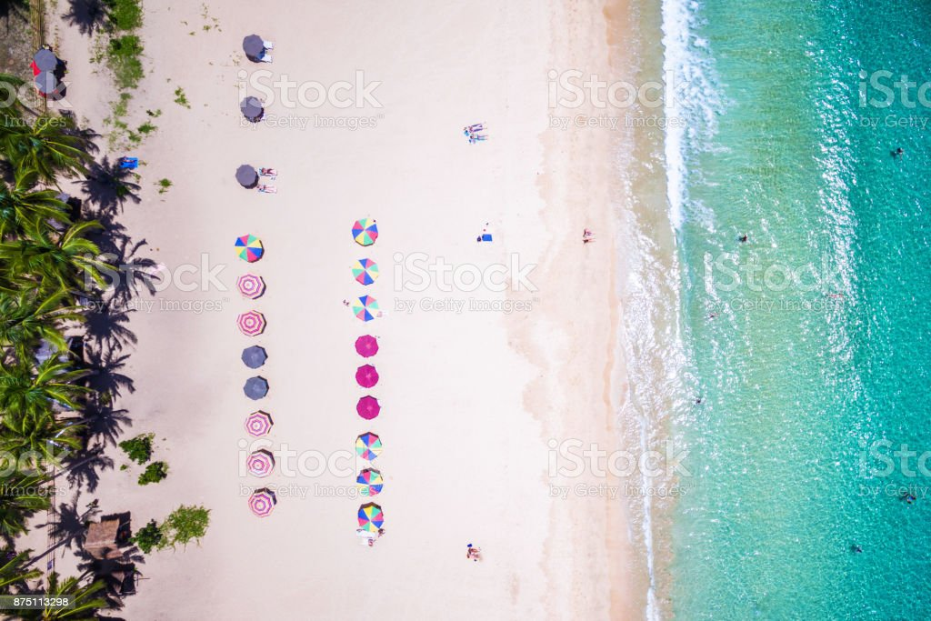 Top View of Beach with Colorful Umbrellas and People Bathing in El Nido, Palawan, Philippines stock photo