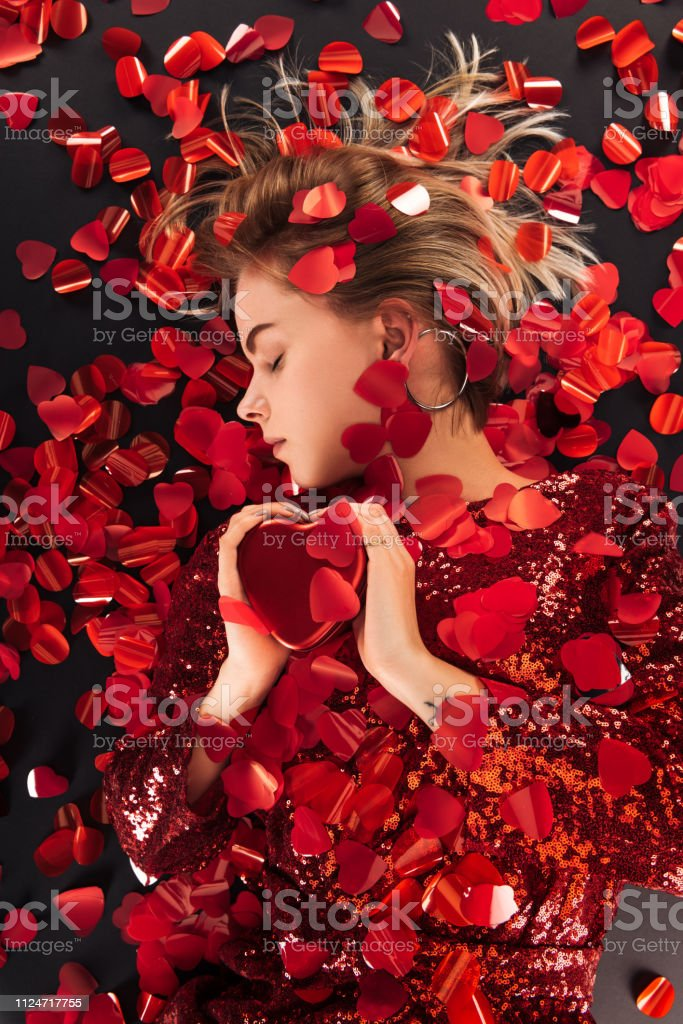 Top View Of Beautiful Girl Holding Heart Symbol With Heart Shaped Confetti Isolated On Black St Valentines Day Concept Stock Photo Download Image Now Istock