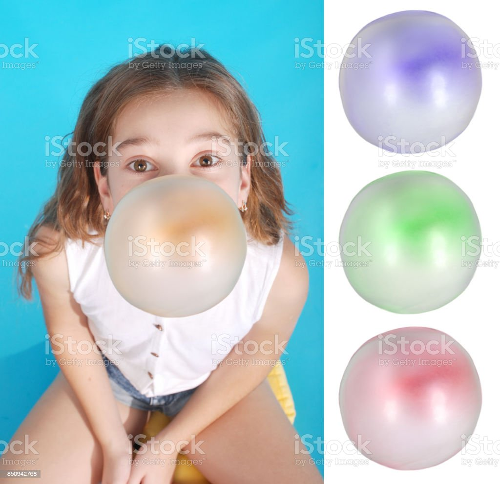 Top view of beautiful young brunette girl blowing bubble gum stock photo